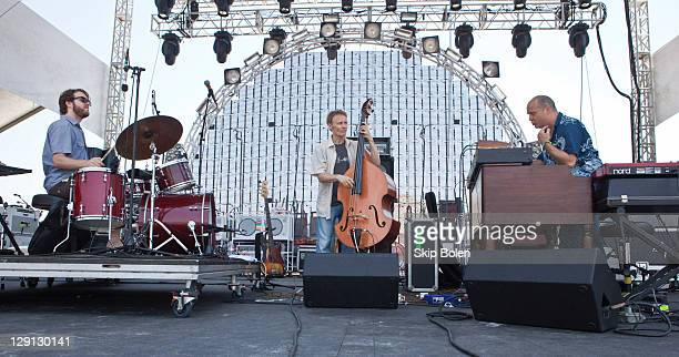 Percussionist Billy Martin bassist Chris Wood and keyboardist John Medeski of Medeski Martin Wood performs during the 2011 Hangout Music Festival on...