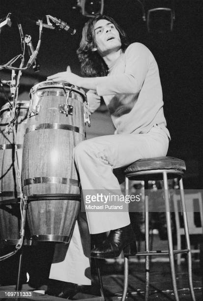 Percussionist Mickey Finn , of English glam rock group T-Rex, playing congas on stage during a soundcheck at Newcastle City Hall, 24th June 1972.