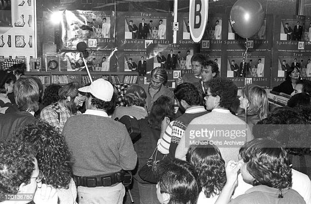 Percussionist Steve Norman and other members of the pop band 'Spandau Ballet' sign autographs at Tower Records Hollywood in 1983 in Los Angeles...