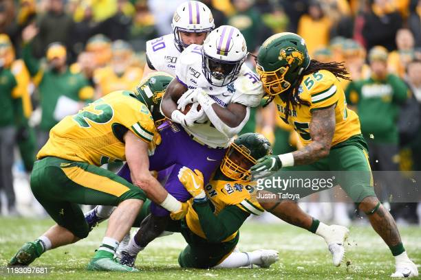 Percy Agyei-Obese of the James Madison Dukes rushes against the North Dakota State Bison during the Division I FCS Football Championship held at...