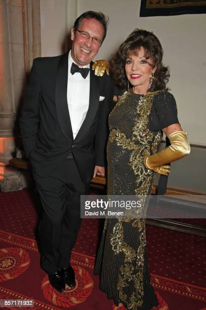 Percy Gibson and Dame Joan Collins attend the BFI and IWC Luminous Gala at The Guildhall on October 3 2017 in London England
