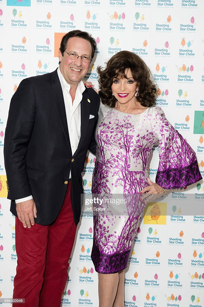 Percy Gibson and Joan Collins arrive for Star Chase Children's Hospice Event at The Dorchester on May 27, 2016 in London, England.