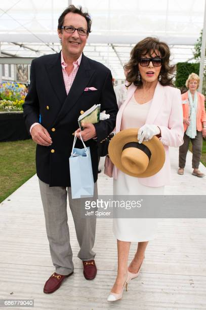Percy Gibson and Joan Collins attend RHS Chelsea Flower Show press day at Royal Hospital Chelsea on May 22 2017 in London England