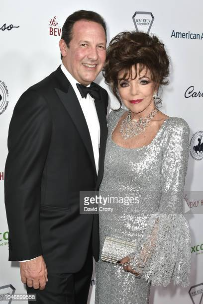 Percy Gibson and Joan Collins attend the 2018 Carousel Of Hope Ball at The Beverly Hilton Hotel on October 6 2018 in Beverly Hills California