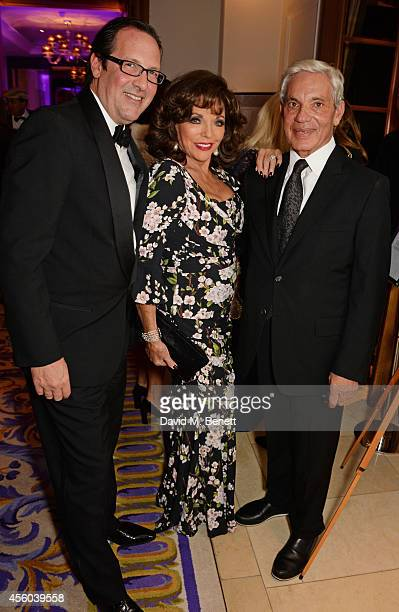 Percy Gibson Joan Collins and Simon Reuben attend the Al Pacino BFI Fellowship Dinner supported by Moet Chandon at the Corinthia Hotel London on...