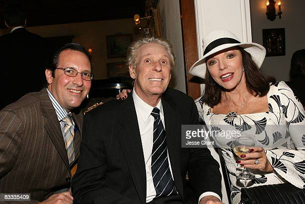 Percy Gibson Nolan Miller and Joan Collins attend the wedding of Michael Feinstein and Terrence Flannery held at a private residence on October 17...