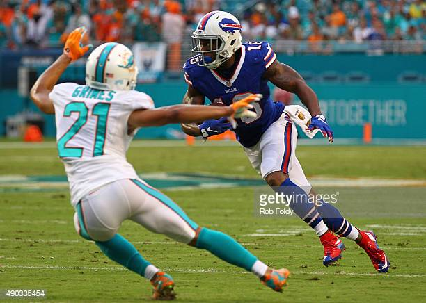 Percy Harvin of the Buffalo Bills is defended by Brent Grimes of the Miami Dolphins during the first half of the game at Sun Life Stadium on...