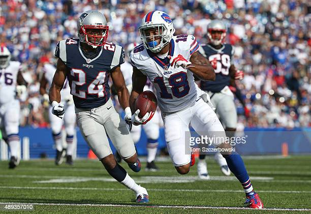 Percy Harvin of the Buffalo Bills runs after the catch during NFL game action as Bradley Fletcher of the New England Patriots gives chase at Ralph...