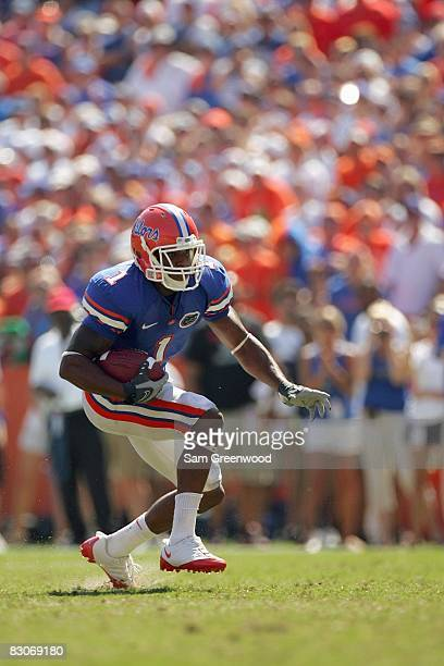 Percy Harvin of the Florida Gators carries the ball during the game against the Mississippi Rebels at Ben Hill Griffin Stadium on September 27, 2008...