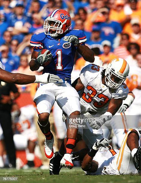 Percy Harvin of the Florida Gators slips a tackle attempt by Jonathan Hefney of the Tennessee Volunteers at Ben Hill Griffin Stadium on September 15,...