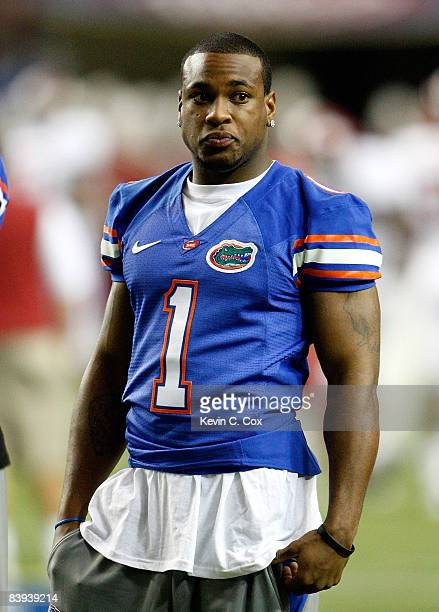 Percy Harvin of the Florida Gators watches pregame warmups before the start of the SEC Championship against the Alabama Crimson Tide during the SEC...