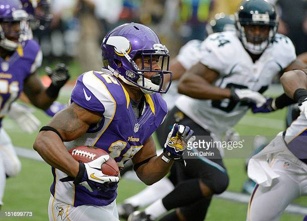 Percy Harvin of the Minnesota Vikings caries the ball during the season opener against the Jacksonville Jaguars at Mall of America Field at the...