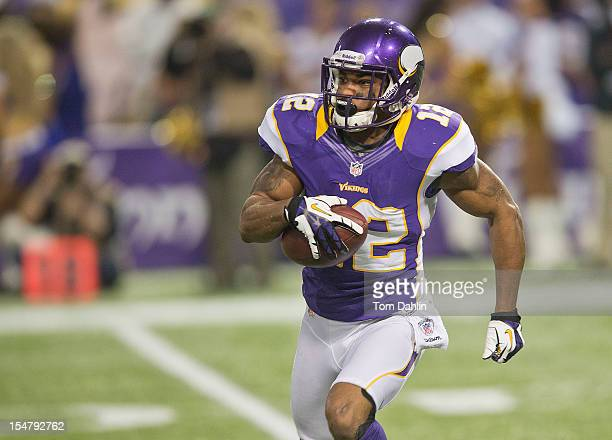 Percy Harvin of the Minnesota Vikings carries the ball during an NFL game against the Tampa Bay Buccaneers at Mall of America Field at the Hubert H...