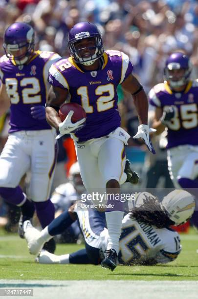 Percy Harvin of the Minnesota Vikings runs back the openig kick for a touchdown during their season opener against the San Diego Chargers on...
