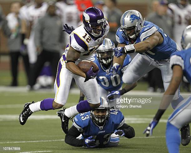Percy Harvin of the Minnesota Vikings tries to escape the tackles of Ndamukong Suh Nathan Vasher and Eric King of the Detroit Lions at Ford Field on...