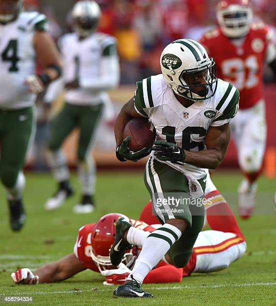 Percy Harvin of the New York Jets runs the ball past Josh Mauga of the Kansas City Chiefs during the game at Arrowhead Stadium on November 2 2014 in...