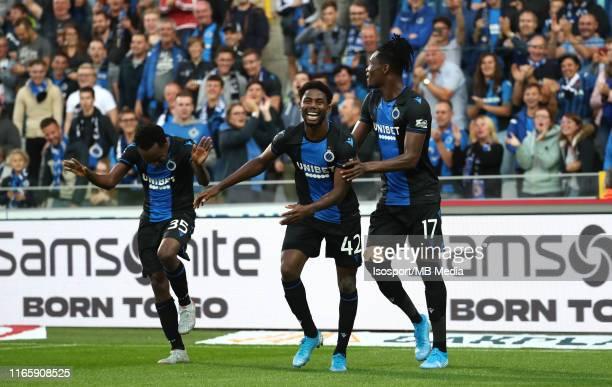 Percy Tau of Club Brugge celebrates with Emmanuel Bonaventure Dennis of Club Brugge and Simon Deli of Club Brugge after scoring a goal during the...