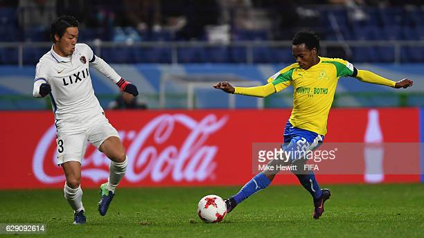 Percy Tau of Mamelodi Sundowns takes on Gen Shoji of Kashima Antlers during the FIFA Club World Cup second round match between Mamelodi Sundowns and...