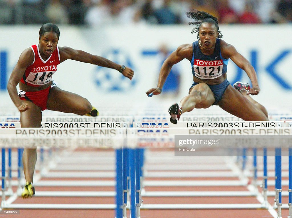 Perdita Felicien of Canada (L) in action next to Gail Devers of USA during the women's 100 meter hurdles semi-final  : News Photo