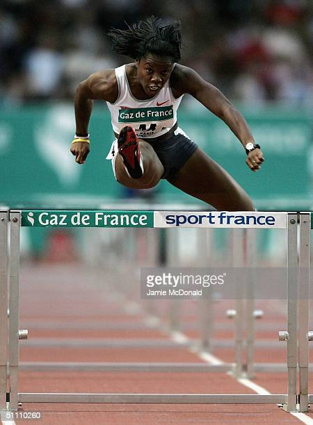 Perdita Felicien of Canada jumps the last hurdle during nthe womens 100m hurdle event at the IAAF Golden League meet at the Stade de France on July...