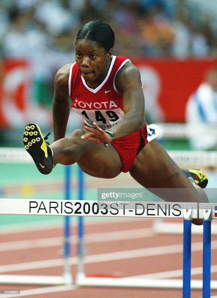 Perdita Felicien of Canada leaps : News Photo