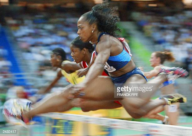 Perdita Felicien of Canada pushes past Gail Devers of the US to win heat one of the 100m hurdles semi-final, 26 August 2003 during the 9th IAAF World...