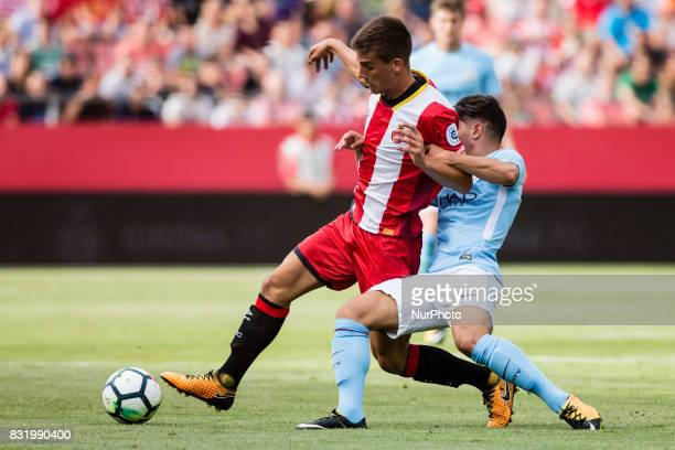 08 Pere Pons from Spain of Girona FC defended by 55 Brahim Diaz from Spain of Manchester City during the Costa Brava Trophy match between Girona FC...