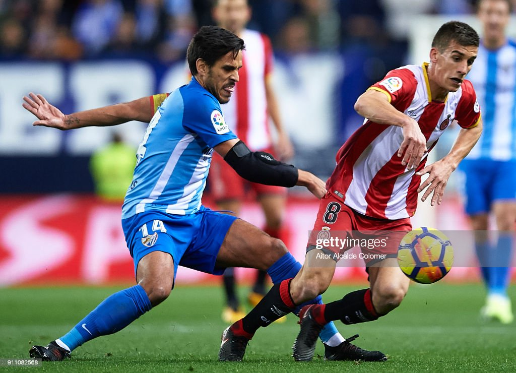 Pere Pons of Gerona FC (R) being followed by Jose Luis Garcia 'Recio' of Malaga CF (L) during the La Liga match between Malaga and Girona at Estadio La Rosaleda on January 27, 2018 in Malaga, Spain.