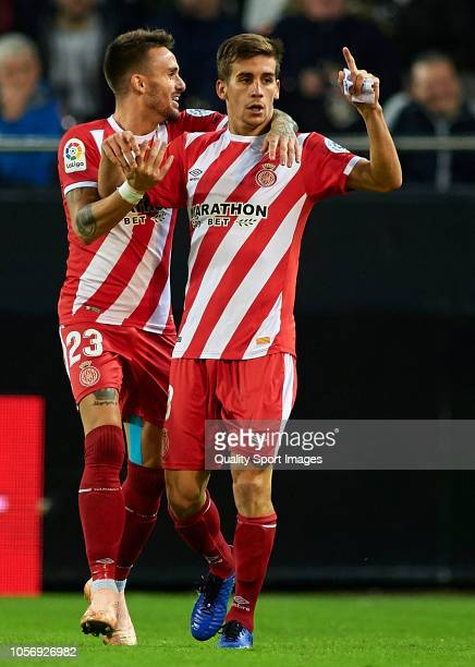 Pere Pons of Girona celebrates after scoring his sides first goal with his teammate Aleix Garcia during the La Liga match between Valencia CF and...