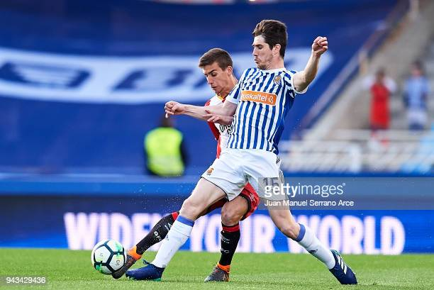 Pere Pons of Girona FC duels for the ball with Aritz Elustondo of Real Sociedad during the La Liga match between Real Sociedad de Futbol and Girona...