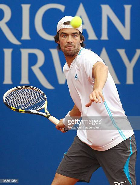 Pere Riba of Spain plays a forehand during his match against Tomas Berdych of Czech Republic at day 4 of the BMW Open at the Iphitos tennis club on...