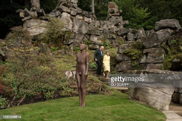 Peregrine 'Stoker' Cavendish Duke of Devonshire and his wife Amanda Duchess of Devonshire admire a sculpture entitled Learning to be I by British...