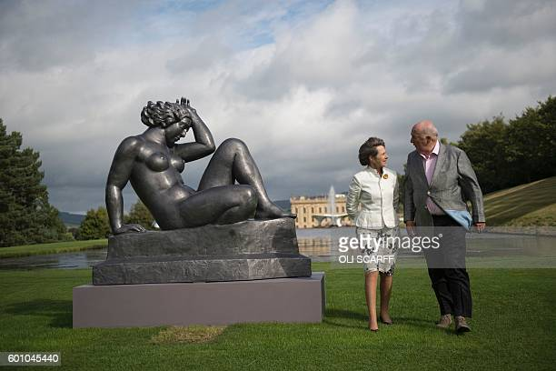 Peregrine 'Stoker' Cavendish Duke of Devonshire and his wife Amanda Duchess of Devonshire pose with a sculpture by French artist Aristide Maillol...