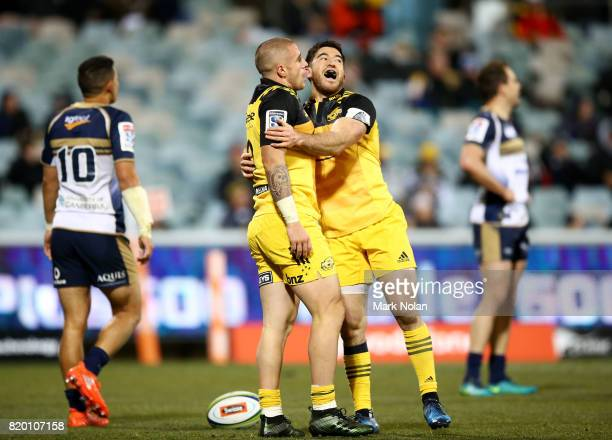 Perenara and Nehe MilnerSkudder of the Hurricanes celebrate a try by Perenara during the Super Rugby Quarter Final match between the Brumbies and the...