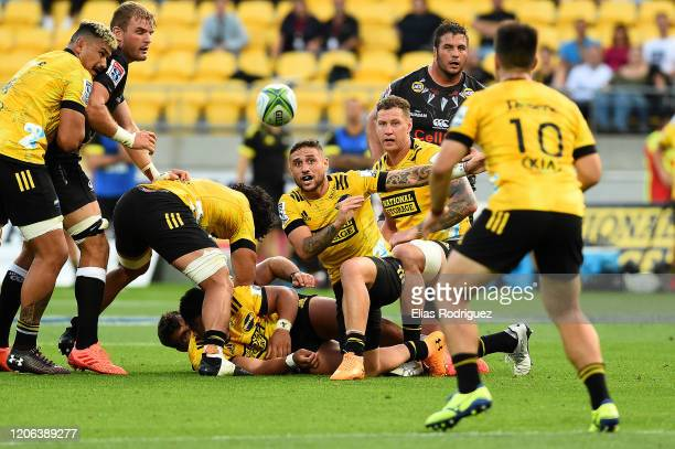 Perenara captain of the Hurricanes passes to Jackson GardenBachop of the Hurricanes during the round 3 Super Rugby match between the Hurricanes and...