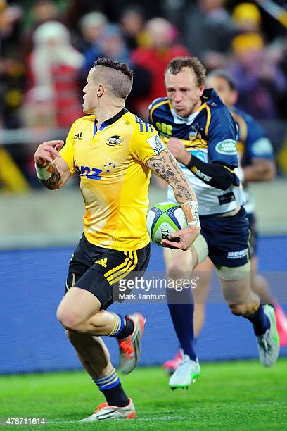 Perenara checks for opposition before scoring during the Super Rugby Semi Final match between the Hurricanes and the Brumbies at Westpac Stadium on...
