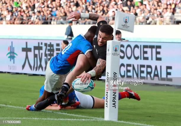 Perenara of New Zealand dives to score his side's eleventh try during the Rugby World Cup 2019 Group B game between New Zealand and Namibia at Tokyo...