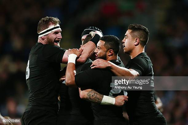 Perenara of New Zealand is mobbed by teammates after scoring a try during the Rugby Championship match between the New Zealand All Blacks and the...