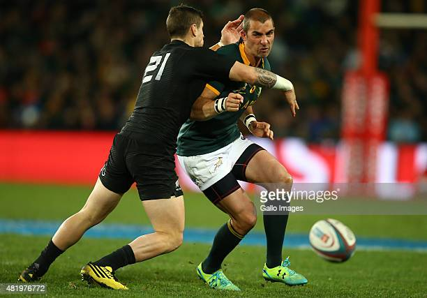 Perenara of New Zealand with a tackle on Ruan Pienaar of South Africa during The Castle Lager Rugby Championship 2015 match between South Africa and...