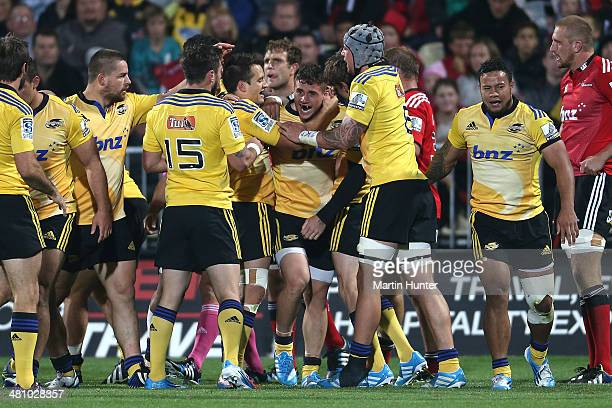 Perenara of the Hurricanes celebrates with team mates after scoring a try gets his pass away during the round seven Super Rugby match between the...
