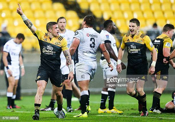 Perenara of the Hurricanes celebrates with teammate Beauden Barrett after scoring a try during the Super Rugby Quarterfinal match between the...