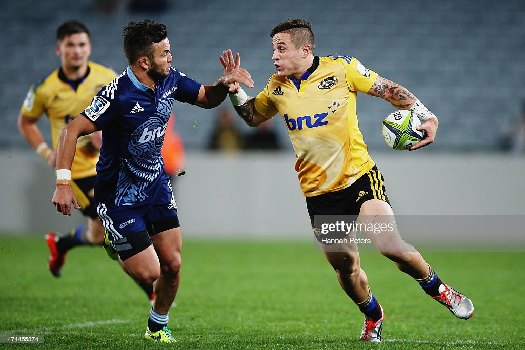 TJ Perenara of the Hurricanes fends off Jamison Gibson-Park of the Blues during the round 15 Super Rugby match between the Blues and the Hurricanes at Eden Park on May 23, 2015 in Auckland, New Zealand.