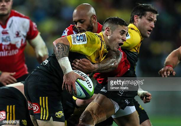 Perenara of the Hurricanes is tackled during the 2016 Super Rugby Final match between the Hurricanes and the Lions at Westpac Stadium on August 6...