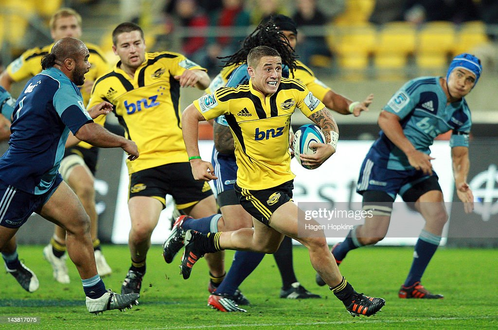 TJ Perenara of the Hurricanes makes a break during the round 11 Super Rugby match between the Hurricanes and the Blues at Westpac Stadium on May 4, 2012 in Wellington, New Zealand.