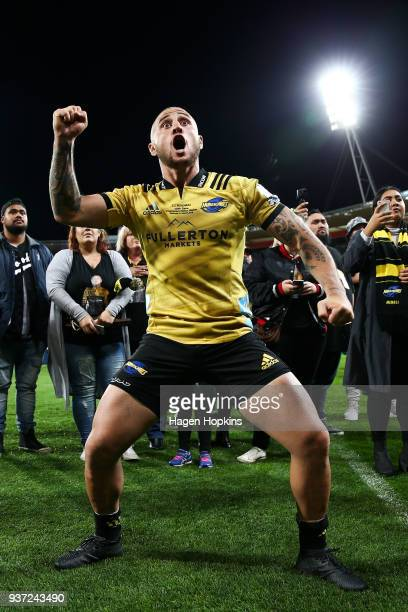 Perenara of the Hurricanes responds to a haka from supporters in recognition of his 100th game during the round six Super Rugby match between the...