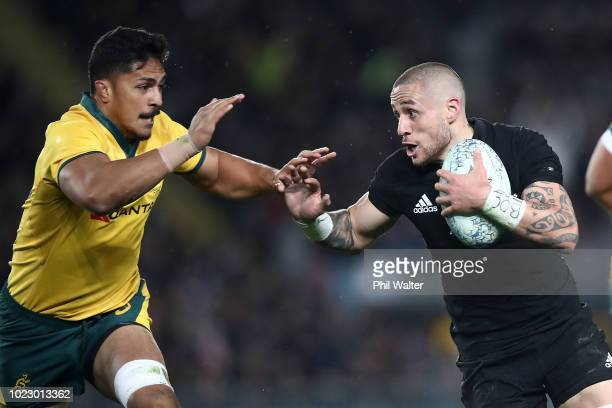 Perenara of the New Zealand All Blacks fends off Pete Samu of the Australian Wallabies during The Rugby Championship game between the New Zealand All...