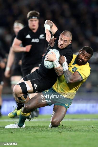 Perenara of the New Zealand All Blacks is tackled by Marika Koroibete of the Australian Wallabies during The Rugby Championship game between the New...