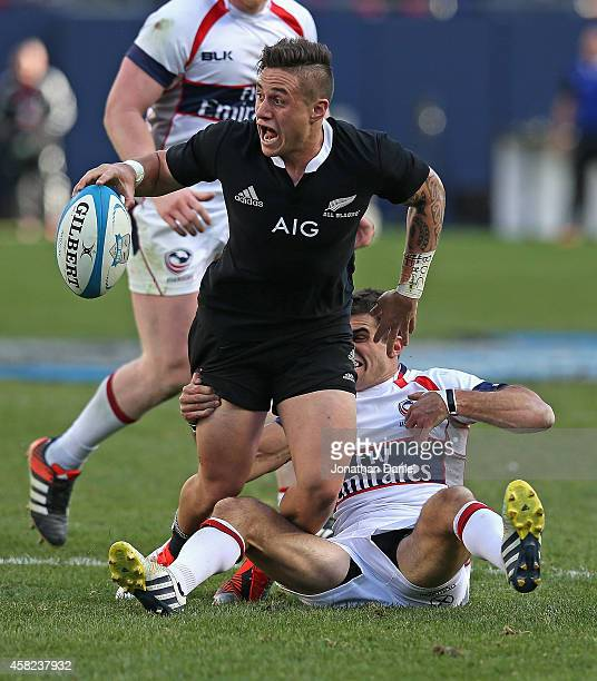 J Perenara of the New Zealand All Blacks passes as he is tackled by Mike Petri of the United States of America Eagles during an International Test...