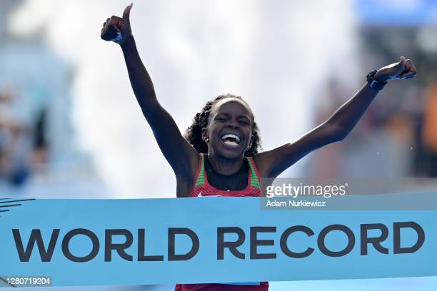 Peres Jepchirchir of Kenya crosses the finish line to win the Women's Final Run during the World Athletics Half Marathon Championships on October 17,...