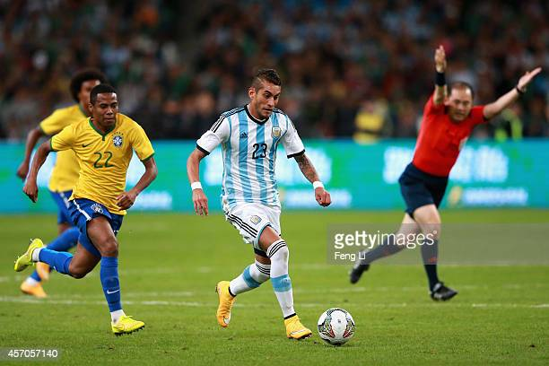 Pereyra of Argentina competes the ball with Pastore of Brazil during Super Clasico de las Americas between Argentina and Brazil at Beijing National...